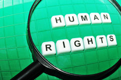 Human rights. Focus on human rights concept with key words under magnifying glass stock photography