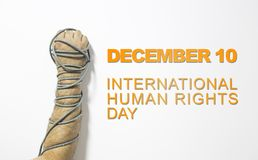 Human rights concept: chained man against the text: Human rights day written on blackboard. Human rights concept: chained man against the text: Human rights day royalty free stock image