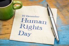 Human rights day - napkin note. Human Rights Day 10 December  - handwriting on a napkin with a cup of coffee Royalty Free Stock Photography