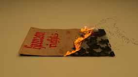 Human rights. Old paper  burning Stock Photography