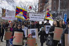 Human Rights for Tibet. 3-10-13 Boston Tibetan Community march on a beautiful sunny winter day through the Boston Common. In the period between March 2011 and Stock Photo