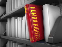 Human Rights - Title of Red Book. Human Rights - Book on the Black Bookshelf Between White Ones royalty free illustration
