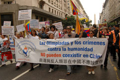 Human Rights Torch in Buenos Aires. The Olympics and Crimes Against Humanity Cannot Coexist in China Royalty Free Stock Photo