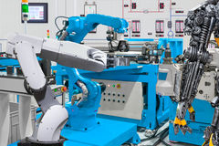 Human robot control automatic robotic hand machine tool industry. Human robot control automatic robotic hand machine tool at industrial manufacture factory Royalty Free Stock Image