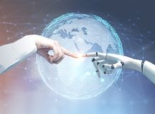 Human and robot hands reaching out, planet stock image