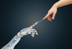 Human and robot hands reaching to each other Stock Images