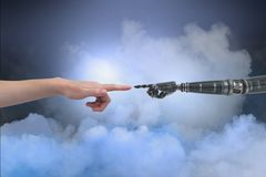 Human and robot touching their fingers in cloudy background Stock Images