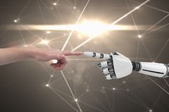 Human and robot touching their fingers in grey background Stock Photography