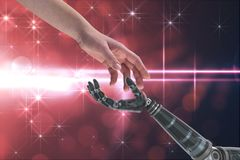 Human and robot touching their hands in red background. Digital composite of human and robot hand Royalty Free Stock Images