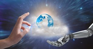 Human and robotic hand gesturing against globe in background royalty free stock image
