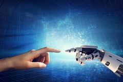 Human and robotic hand touching fingers. Artificial intelligence, modern smart technology stock photos