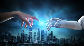 Human And Robotic Hand Touching Fingers stock photography