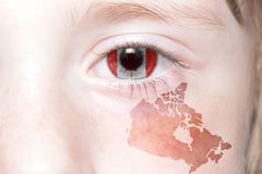 Human& x27;s face with national flag and map of canada. Stock Photos