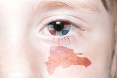 Human& x27;s face with national flag and map of dominican republic. Concept royalty free stock images