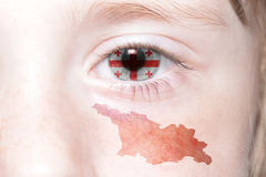 Human& x27;s face with national flag and map of georgia. Royalty Free Stock Image