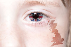 Human& x27;s face with national flag and map of great britain. stock image
