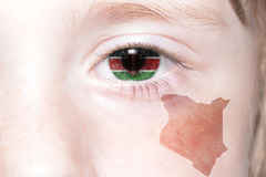 Human& x27;s face with national flag and map of kenya. Concept royalty free stock images