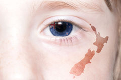 Human& x27;s face with national flag and map of new zealand. stock image