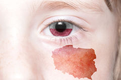 Human& x27;s face with national flag and map of poland. Concept royalty free stock photo