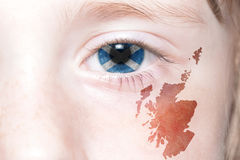 Human& x27;s face with national flag and map of scotland. Concept stock photo