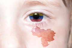 Human& x27;s face with national flag and map of venezuela. Concept royalty free stock images