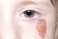 Human`s face with national flag of united states of america and illinois state map. Concept Royalty Free Stock Image