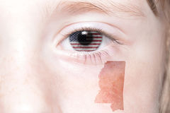 Human`s face with national flag of united states of america and mississippi state map Stock Image