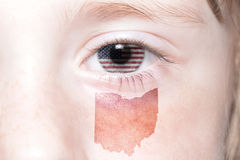 Human`s face with national flag of united states of america and ohio state map. Concept stock photos