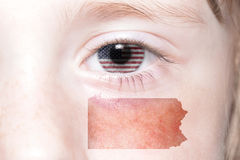 Human`s face with national flag of united states of america and pennsylvania state map Stock Image