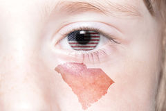 Human`s face with national flag of united states of america and south carolina state map Stock Image