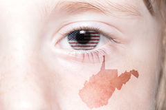 Human`s face with national flag of united states of america and west virginia state map Stock Images