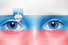 Human`s face with slovenian flag Royalty Free Stock Photos