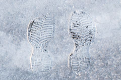 Human`s foot print on a  snow Royalty Free Stock Photography