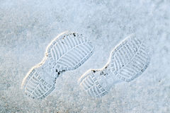 Human`s foot print on a  snow Royalty Free Stock Images