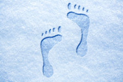 Human's footprints on the snow Stock Images