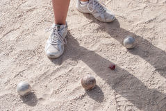 Human's foots in front of petanque balls Stock Photo