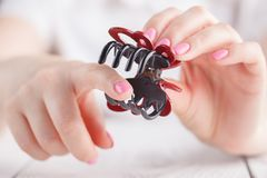 Human`s hand holding hairclip opened Stock Photos