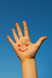 Human's palm with smile on it Stock Image