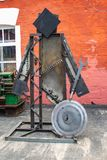 Human sculpture of old , iron tools and parts. On the background of the building royalty free stock photos