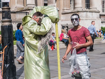 Human sculptures take a break at Trafalgar Square, London Stock Photo