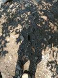 Human shadow on earth royalty free stock photos