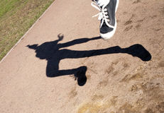 Human shadow in flying jump Stock Photography