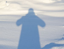 Human shadow on the snow Royalty Free Stock Photography