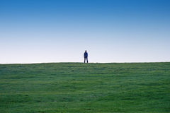 Human shape. Woman shape outside, on a green field Stock Image