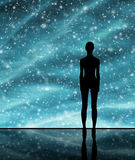 Human shape over the stellar background Stock Image