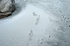 Human shoe print on cold white frozen beach Stock Images