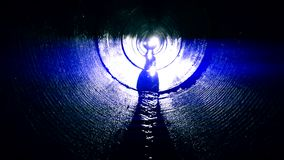 Human silhouette in dark labyrinth tunnel looking for exit. stock video footage