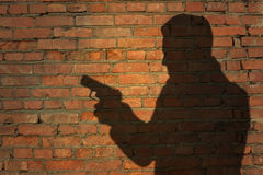 Human silhouette with handgun Royalty Free Stock Image