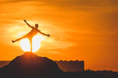 Human silhouette jumping at solar disk sunny summer sunset drive holidays and vacations Royalty Free Stock Photography