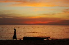 Human silhouette on sea sunset dramatic colors Stock Photography